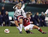 06 November,  2004.  USWNT midfielder Aly Wagner (10) is taken down by Denmark's Catherine Sorensen (7)  at  Lincoln Financial Field in Philadelphia, Pa.