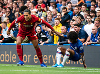 Virgil van Dijk of Liverpool helps up Willian of Chelsea during the Premier League match between Chelsea and Liverpool at Stamford Bridge, London, England on 22 September 2019. Photo by Liam McAvoy / PRiME Media Images.