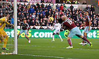 Pictured: Nathan Dyer of Swansea (C) watches on as team mate Bafetimbi Gomis is brought down by James Collins of West Ham thus failing to head the ball in Saturday 10 January 2015<br />