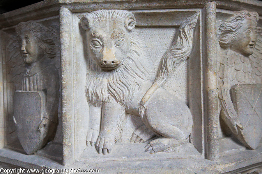 Carved stone lion and angels baptismal font, Church of Saint Gregory, Rendlesham, Suffolk, England, UK