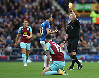 Everton's Leighton Baines yellow card takes Burnley's Robbie Brady down<br /> <br /> Photographer Rachel Holborn/CameraSport<br /> <br /> The Premier League - Everton v Burnley - Sunday 1st October 2017 - Goodison Park - Liverpool<br /> <br /> World Copyright &copy; 2017 CameraSport. All rights reserved. 43 Linden Ave. Countesthorpe. Leicester. England. LE8 5PG - Tel: +44 (0) 116 277 4147 - admin@camerasport.com - www.camerasport.com