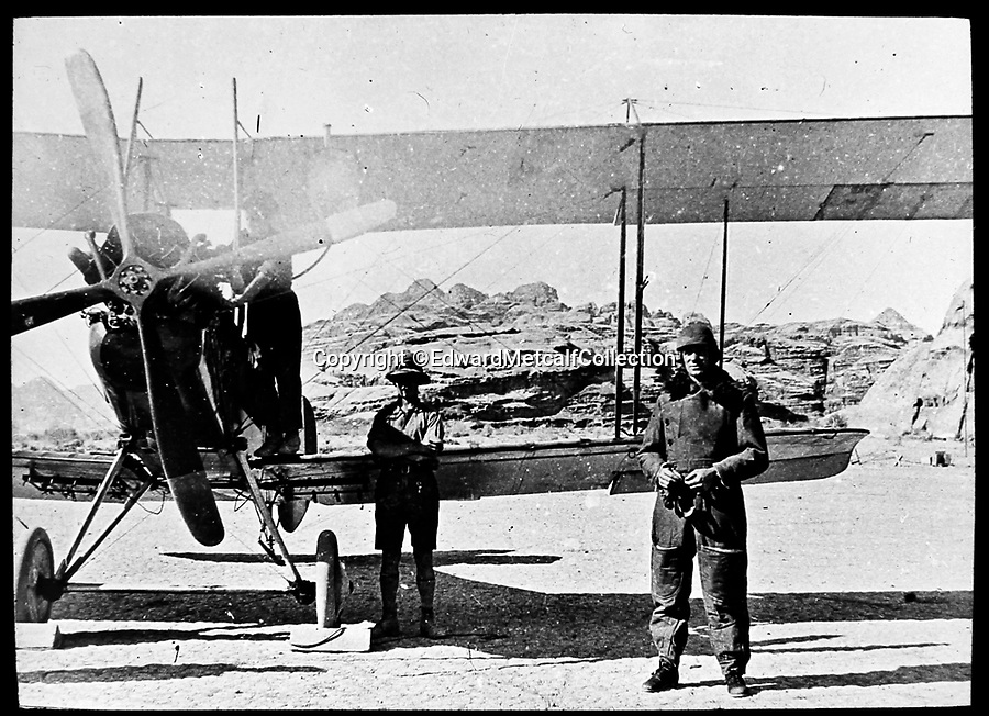 Bournemouth News (01202 558833)<br /> Pic: EdwardMetcalfCollection/BNPS<br /> <br /> Hugh Junor and his BE plane.<br /> <br /> Fascinating never before seen photos of the Arab Revolt have revealed Lawrence of Arabia actually had help from a plucky band of British troops as well as the Arab tribesmen.<br /> <br /> A new book reveals the legendary campaign, that did much to shape the modern map of the Middle East, used cutting edge weapons like Rolls Royce armoured car's and British crewed aircraft to attack the Turkish enemy alongside the native arab army.<br /> <br /> The photos feature in military historian James Stejskal's new book Masters of Mayhem which sheds new light on T.E Lawrence's achievements fighting alongside Arab guerrilla forces in the Middle East during the First World War.<br /> <br /> They had been tucked away in the private photo albums of the descendants of soldiers who fought alongside Lawrence during the campaign.<br /> <br /> One historically important photo shows Lawrence and his driver sitting in a Rolls Royce in Marjeh Square in Damascus after it was captured in October 1918.<br /> <br /> Another documents the dramatic moment a water tower and windmill pump are blown up in the desert.