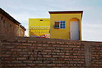 New dental office beside old brick building in Los Algodones, B.C, Mexico.