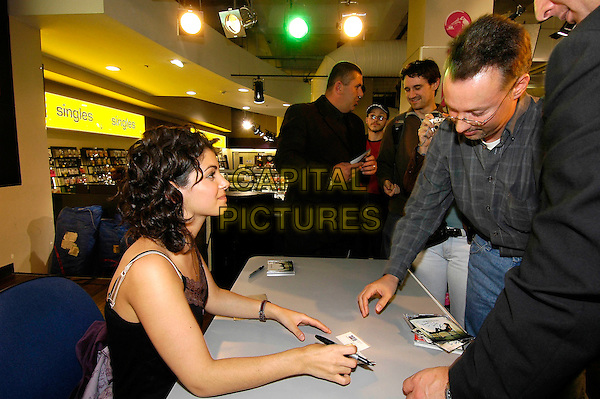 KATIE MELUA.Instore gig & signing at HMV, 150 Oxford Street, W1, London..September 26th, 2005.half length signing autograph profile fan .www.capitalpictures.com.sales@capitalpictures.com.©Capital Pictures