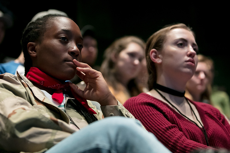 """Students listen to Nathan Singh, director of """"Wig Out!"""" and 3rd year MFA Directing student in The Theatre School, Gloria """"Mama Gloria"""" Allen, retired nurse and a trans-community activist in Chicago, Tarell Alvin McCraney, playwright of """"Wig Out!"""" and Oscar award winning playwright and screenwriter for """"Moonlight,"""" and Lisa Portes, head of Directing at The Theatre School, during a talk with students, faculty and staff from the set of """"Wig Out!"""" on the Fullerton Stage in The Theatre School building, Friday, April 21, 2017. (DePaul University/Jeff Carrion)"""