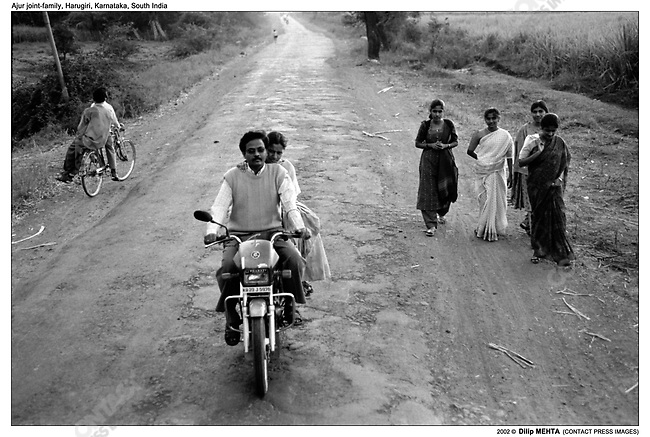 Dr. Kumar and his wife Renuka (also a Doctor) drive out to their clinic in Kontcup village approximately 20 kms. from Harugiri. They live in a house owned by Dr. KumarÕs youngest uncle - Principal B. Ajur. Shortly after they were married last year they moved out of the Joint family home and chose to live separately. This move has caused a deep rift in the family and might precipitate a severance within the brothers and their families. Apparently for the past few years there has been an undercurrent of dissatisfaction with the current state of affairs and joint family arrangements. The younger members of the joint family identify with the Kumar's and are envious of their independent lifestyle. ..Dr. Kumar, son of the sister who lives with the family, was educated by the family. After he graduated with a degree in Ayurvedic medicine a clinic and a pharmacy were set up to establish his practice. To that end whatever funds are generated by the clinic in Harugiri are funneled back to the family treasury. However, to sustain their lifestyle (watching their own TV in a bedroom not shared with others and enjoying a boat ride on the river Krishna) Dr. Kumar and Renuka have opened a second clinic in a small farming community. Apparently the money from this is not shared with the joint family. (I am uncertain about this information)...Even though there is tension between the Kumar's and the elders of the joint family - they, the family members, still show up either at the KumarÕs residence or the clinic for treatment. .