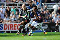 Jonjo Shelvey of Newcastle United turns Mousa Dembele of Tottenham Hotspurduring Newcastle United vs Tottenham Hotspur, Premier League Football at St. James' Park on 13th August 2017