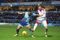Alex Jakubiak of Wycombe Wanderers holds off Josh Payne of Crawley Town during the Sky Bet League 2 match between Wycombe Wanderers and Crawley Town at Adams Park, High Wycombe, England on 25 February 2017. Photo by Andy Rowland / PRiME Media Images.