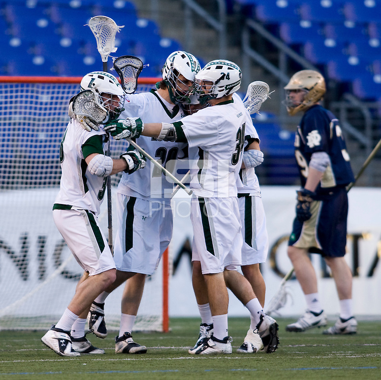 Collin Finnerty (20) of Loyola celebrates his goal with teammates during the Face-Off Classic in at M&T Stadium in Baltimore, MD