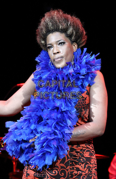 Macy Gray .performs at The Pearl inside Palms Casino Resort, Las Vegas, Nevada, USA, 4th August 2012..music concert live gig on stage half length blue feather boa red black print dress .CAP/ADM/MJT.© MJT/AdMedia/Capital Pictures.