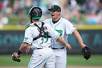 Dayton Dragons relief pitcher Joel Kuhnel (36) celebrates with catcher Cassidy Brown (39) after closing out the win over the West Michigan Whitecaps at Fifth Third Field on May 29, 2017 in Dayton, Ohio.  The Dragons defeated the Whitecaps 4-2.  (Brian Westerholt/Four Seam Images)
