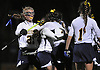 Massapequa No. 21 Shannon Bernhardt, far left, and teammates celebrate after a goal by No. 2 Jennifer Cooney gave them a 1-0 lead over Baldwin in the Nassau County varsity field hockey Class A final at Adelphi University on Saturday, October 31, 2015. Massapequa extended its lead to 2-0 in the second half and held on to win 2-1.<br /> <br /> James Escher<br /> <br /> James Escher