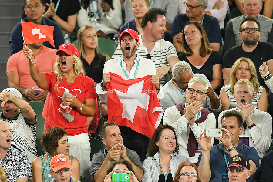 January 29, 2017: Swiss fans cheer on Roger Federer of Switzerland in the Men's Final against Rafael Nadal of Spain on day 14 of the 2017 Australian Open Grand Slam tennis tournament in Melbourne, Australia. Photo Sydney Low