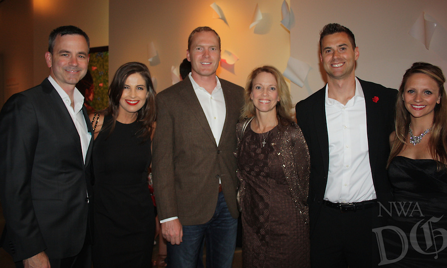 NWA Democrat-Gazette/CARIN SCHOPPMEYER Dr. Philip and Mar (cq) Woodworth (from left), Dr. James and Felicia Ragland and Bill and Haley Hewlett visit at the Red Shoe Soiree at 21c in Bentonville.