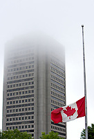 An half-masted Canadian flag flies on a foggy day in Quebec city July 1, 2009.<br /> <br /> PHOTO :  Francis Vachon - Agence Quebec Presse