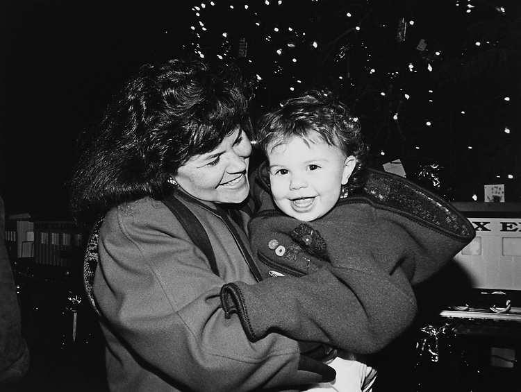 Rep. Enid Greene Mickelsen, R-Utah and daughter Elizabeth (15 months) at Christmas tree lighing event on Dec. 12, 1996. (Photo by Laura Patterson/CQ Roll Call)