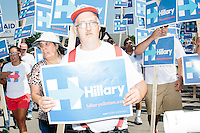 David Cloutier, of Milford, a supporter of Democratic presidential candidate Hillary Clinton, marches in the Labor Day parade in Milford, New Hampshire. Though Clinton did not march in the parade, Republican candidates John Kasich, Carly Fiorina, and Lindsey Graham, and Democratic candidate Bernie Sanders did march in the parade.