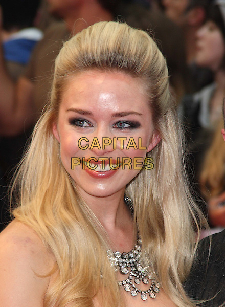 Noelle Reno .World Premiere of 'Larry Crowne' at the Vue Cinema, Westfield Shopping Centre, London, England, UK, .June 6th 2011..portrait headshot smiling  make-up necklace hair bouffant beauty strapless.CAP/JIL.©Jill Mayhew/Capital Pictures