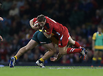 Australia lock Michael Hooper tackles Wales outside half Dan Biggar.<br /> Dove Men Series 2014<br /> Wales v Australia<br /> Millennium Stadium<br /> 08.11.14<br /> ©Steve Pope-SPORTINGWALES