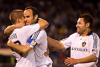 18 April 2009: Landon Donovan of the Galaxy and Dema Kovalenko of the Galaxy celebrate with Bryan Jordan of the Galaxy after Jordan scored a goal in the second half of the game against the Earthquakes at Oakland-Alameda County Coliseum in Oakland, California.   Earthquakes and Galaxy are tied 1-1.