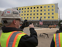 NWA Democrat-Gazette/J.T. WAMPLER Don Greenland, strategic growth officer for Nabholz Construction takes a photograph during a beam signing ceremony for a new residence hall Tuesday Dec. 4, 2018 at the University of Arkansas. The new residence halls will house around 700 students and are built using mass timber construction.