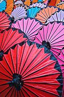 Pattern of newly assembled decorative umbrellas drying in sun, Umbrella Making Center, Bo Sang, near Chiang Mai, Thailand.