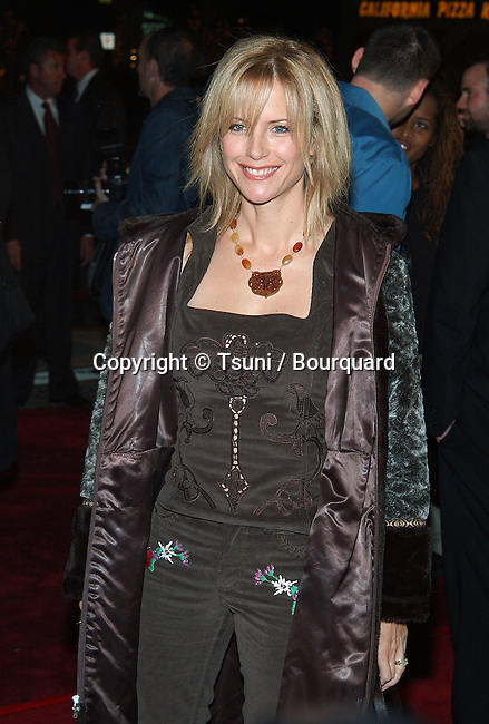 Kelly Preston arriving at the 8 Mile Premiere at the Westwood Village Theatre in Los Angeles. November 6, 2002.           -            PrestonKelly026.jpg