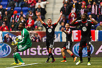 D. C. United players including goalkeeper Bill Hamid (28), Perry Kitchen (23), Chris Korb (22), and Brandon McDonald (4) react to a linesman's call. The New York Red Bulls and D. C. United played to a 0-0 tie during a Major League Soccer (MLS) match at Red Bull Arena in Harrison, NJ, on March 16, 2013.