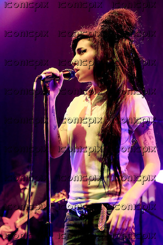 Amy Winehouse - performing live at the Astoria in London UK - 19 Feb 2007.  Photo credit: George Chin/IconicPix