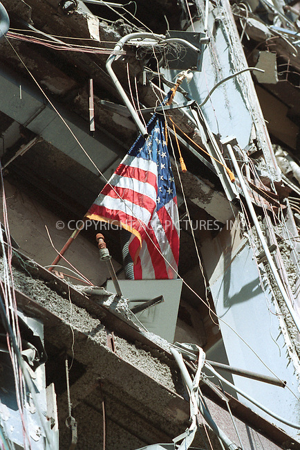 ***NO USA SYNDICATION RIGHTS***..   ..The American flag flies precariously out of an office window at the New York Customhouse at the World Trade 6 building at ground zero. September 2001. Please byline: USCS/NY Photo Press.   ....NY Photo Press:  ..phone (646) 267-6913;   ..e-mail: info@nyphotopress.com
