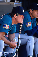 OAKLAND, CA - Manager Lou Piniella of the Seattle Mariners sits in the dugout during a game against the Oakland Athletics at the Oakland Coliseum in Oakland, California on May 25, 1994. (Photo by Brad Mangin)