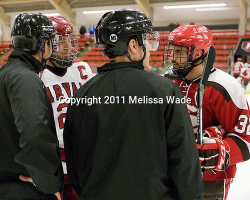Jean-Yves Roy, Chris Huxley (Harvard - 28), Dean Gilbert, Aaron Bogosian (St. Lawrence - 32) - The Harvard University Crimson defeated the St. Lawrence University Saints 4-3 on senior night Saturday, February 26, 2011, at Bright Hockey Center in Cambridge, Massachusetts.