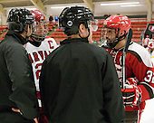 Jean-Yves Roy, Chris Huxley (Harvard - 28), Dean Gilbert, Aaron Bogosian (St. Lawrence - 32) - The Harvard University Crimson defeated the St. Lawrence University Saints 4-3 on senior night Saturday, February 26, 2011, at Bright Hockey Center in Cambridge, Massachusetts.