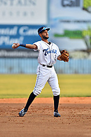 Asheville Tourists shortstop Carlos Herrera (2) warms up during a game against the West Virginia Power at McCormick Field on May 10, 2017 in Asheville, North Carolina. The Tourists defeated the Power 4-3. (Tony Farlow/Four Seam Images)