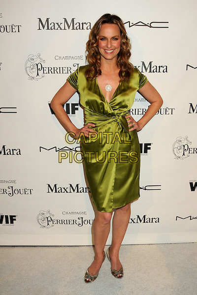 MELORA HARDIN .3rd Annual Women In Film Pre-Oscar Party held at a Private Residence in Beverly Hills, California, USA, .4th March 2010..full length green silk satin dress wrap hands on hips .CAP/ADM/BP.©Byron Purvis/AdMedia/Capital Pictures.