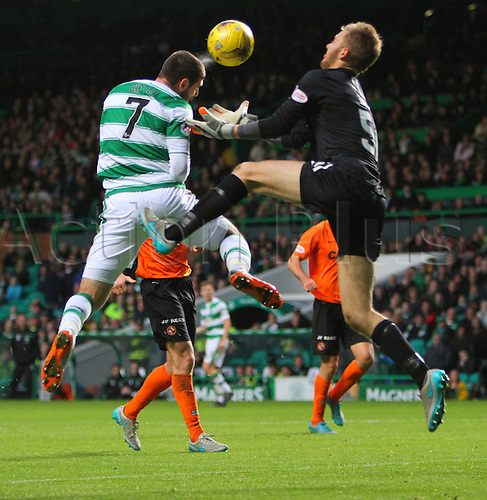 25.10.2015. Glasgow, Scotland. Scottish Premier League. Celtic versus Dundee United. Nadir Ciftci beats Luis Zwick to the ball