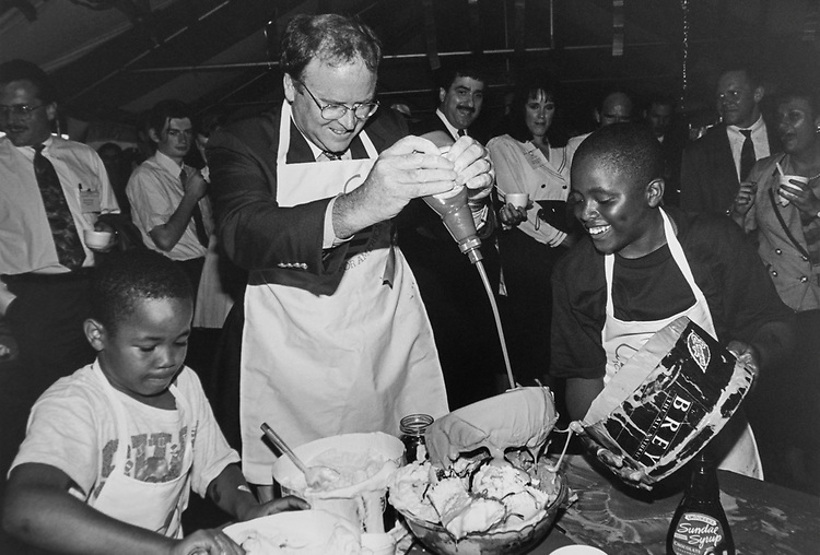 Rep. Sam Farr, D-Calif., preparing an ice-cream along with the help of Quinell Wilder (9) and Reginald Lampkins (12) from United Way sponsored Friendship House Association. Sundae in the 'Super Bowl, I Sundae contest' and obviously having a great time doing it, on June 16, 1944. (Photo by Maureen Keating/CQ Roll Call via Getty Images)