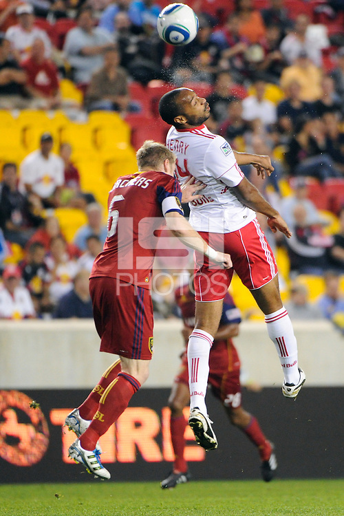 Thierry Henry (14) of the New York Red Bulls and Nat Borchers (6) of Real Salt Lake. Real Salt Lake defeated the New York Red Bulls 3-1 during a Major League Soccer (MLS) match at Red Bull Arena in Harrison, NJ, on September 21, 2011.