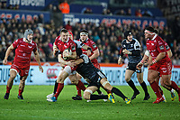 Johnny McNicholl of the Scarlets is brought down Dan Evans of the Ospreys by during the Guinness Pro14 Round 11 match between the Ospreys and the Scarlets at the Liberty Stadium, Swansea, Wales, UK. Saturday 22 December 2018