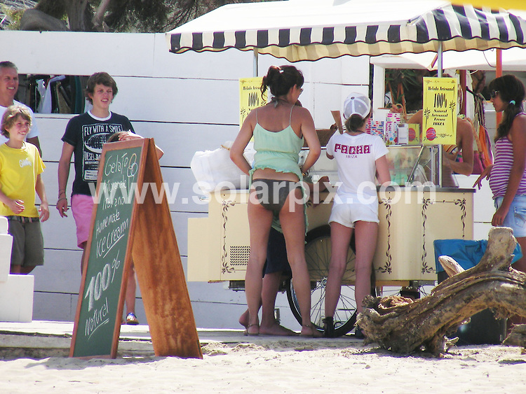 **ALL ROUND EXCLUSIVE PICTURES FROM SOLARPIX.COM**.**WORLDWIDE SYNDICATION RIGHTS EXCLUDING SPAIN - NO PUBLICATION IN SPAIN**.Ex England and Spurs footballer Gary Lineker and sexy model girlfriend Danielle Bux on a family holiday in Ibiza this week. The couple took the kids to a popular beach where they bought ice creams to cool themselves down, before returning to their secluded villa in the hills..JOB REF:   9606    RMJ       DATE:  26.07.09.**MUST CREDIT SOLARPIX.COM OR DOUBLE FEE WILL BE CHARGED**.**ONLINE USAGE FEE GBP 50.00 PER PICTURE - NOTIFICATION OF USAGE TO PHOTO @ SOLARPIX.COM**.**CALL SOLARPIX : +34 952 811 768 or LOW RATE FROM UK 0844 617 7637**