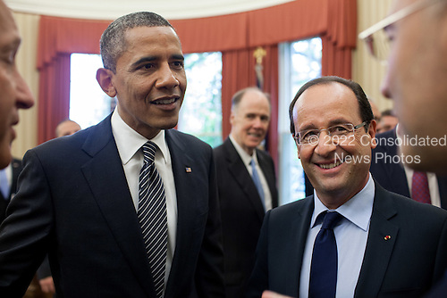 United States President Barack Obama and President François Hollande of France, with interpreters, hold a discussion following their bilateral meeting in the Oval Office, May 18, 2012. .Mandatory Credit: Pete Souza - White House via CNP