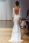 Model walks runway in a Pearl gown from the Beloved Bridal collection at the Casablanca Bridal 20th anniversary celebration runway show, on October 8, 2017; during New York Bridal Fashion Week Spring 2018.