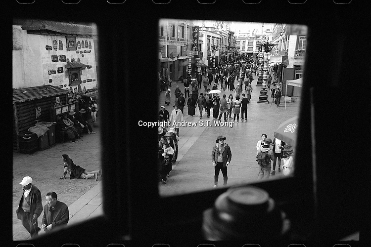 A general view of Barkhor Street outside the Jokhang Temple is seen through the window of a cafe in Lhasa, Tibet, September 2016.