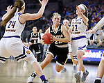 SIOUX FALLS, SD: MARCH 6: Mikaela Shaw #22 of Omaha drives between Michelle Farrow #22 and Taylor Higginbotham #24 of Western Illinois during the Summit League Basketball Championship on March 6, 2017 at the Denny Sanford Premier Center in Sioux Falls, SD. (Photo by Dick Carlson/Inertia)