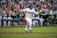 Mike Rivera (4) of the Florida Gators bats during a game between the Miami Hurricanes and Florida Gators at TD Ameritrade Park on June 13, 2015 in Omaha, Nebraska. (Brace Hemmelgarn/Four Seam Images)