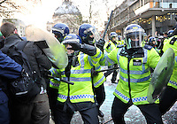 Police clash with protestors during a student demonstration in Westminster, central London on the day the government passed a bill to increase university tuition fees.