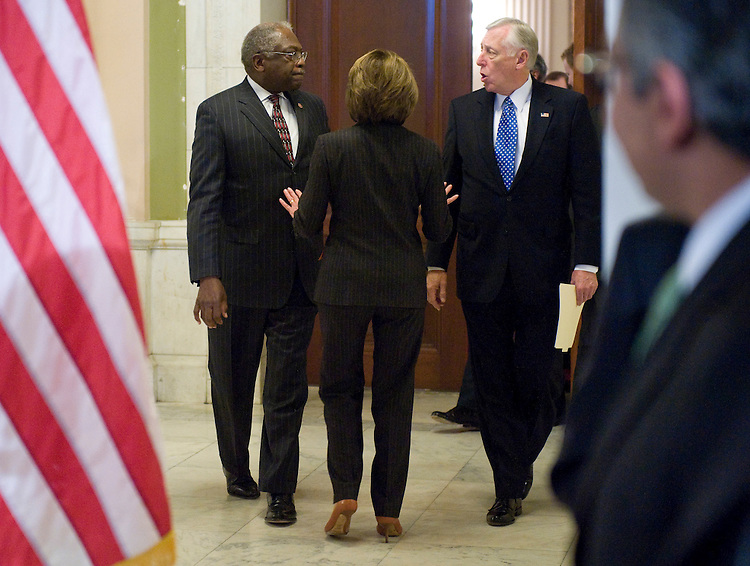From left, House Majority Whip Jim Clyburn, D-S.C., Speaker of the House Nancy Pelosi, D-Calif., and House Majority Leader Steny Hoyer, D-Md., talk as they head out to speak to the media following a House Democratic Caucus meeting in the Cannon House Office Building on Tuesday, Dec. 9, 2008.