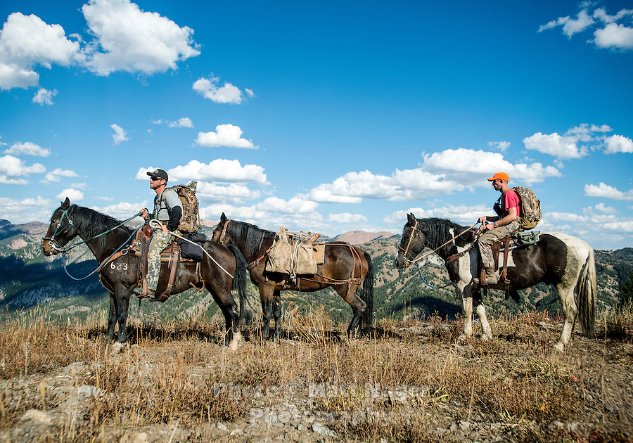 Hunter Mike Stock and guide Greg Kriese with Trefren Outfitters on Greyback Ridge in the Hoeback Drainage of Wyoming Region H, outside of Alpine, Wyoming, September 22, 2015.<br /> <br /> Photo by Matt Nager