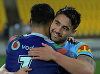 Shaun Johnson (Sharks, right) hugs Roger Tuivasa-Sheck (Warriors) after the National Rugby League match between the NZ Warriors and Cronulla Sharks at Westpac Stadium in Wellington, New Zealand on Friday, 19 July 2019. Photo: Dave Lintott / lintottphoto.co.nz