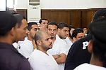 Egyptian defendants in the case of US embassy violence stand in during a hearing at a court in Cairo on April 23, 2015. The Cairo Criminal Court delayed the trial of 23 of members of Muslim Brotherhood accusing in the violence outside the US embassy to 14 May. Photo by Amr Sayed